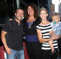 NEW YORK, NY - AUGUST 13, 2012:  Chris Powell, Sally Adams-extreme makeover, with his wife Heidi Powell and son William Cash at Good Morning America to talk about Extreme Makeover:Weight Loss Edition in New York City  :© RW/MediaPunch Inc.