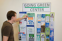 A mid adult man checking out the environmental resource notice board at the library. The San Mateo Public Library integrates significant green building practices and achieved LEED Silver certification. Green features include extensive daylighting, efficient underfloor air supply, venting windows, low VOC materials, native plant landscaping, and much more. San Mateo, California, USA