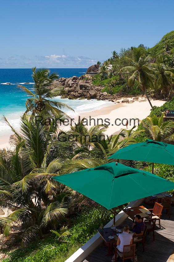 Seychelles, Island Mahe, Anse Intendance: Banyan Tree Hotel - terrace, patio, couple at breakfast