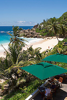 Seychelles, Island Mahe, Anse Intendance: Banyan Tree Hotel - terrace, patio, couple at breakfast