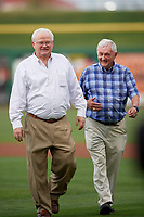Minor League President Pat O'Conner (left) and Florida State League President Ken Carson walk off the field after Carson threw out the ceremonial first pitch before a game between the Clearwater Threshers and Dunedin Blue Jays on April 4, 2019 at Spectrum Field in Clearwater, Florida.  Dunedin defeated Clearwater 11-1.  (Mike Janes/Four Seam Images)