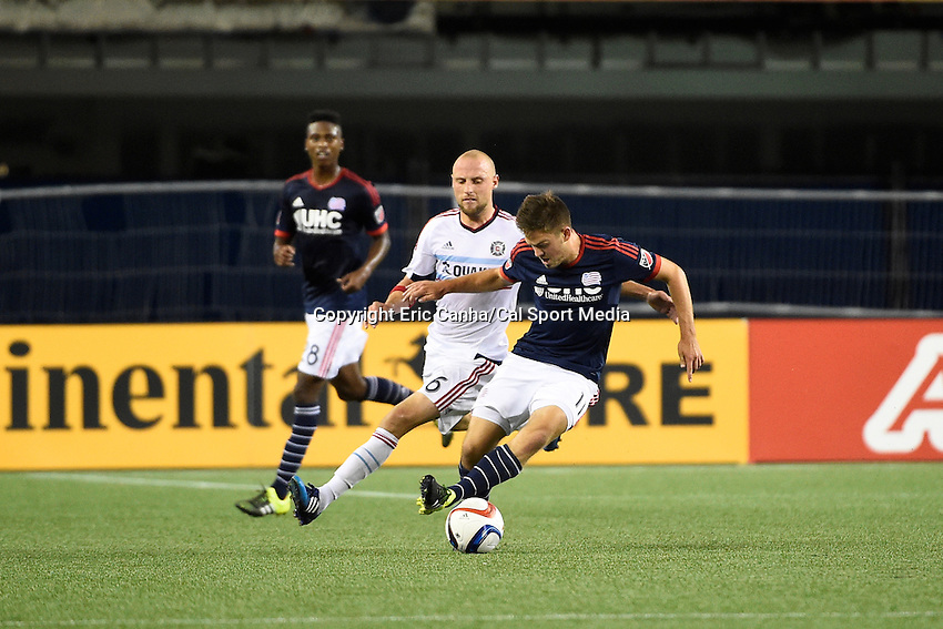 June 13, 2015 - Foxborough, Massachusetts, U.S. - New England Revolution midfielder Kelyn Rowe (11) controls te ball in front of Chicago Fire defender Eric Gehrig (6) during the MLS game between Chicago Fire and the New England Revolution held at Gillette Stadium in Foxborough Massachusetts. The Revolution defeated the Fire 2-0. Eric Canha/CSM