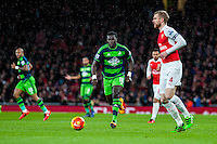 Bafetibi Gomis of Swansea City  in action during the Barclays Premier League match between Arsenal and Swansea City at the Emirates Stadium, London, UK, Wednesday 02 March 2016