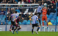 Leeds United's (right) Kiko Casilla competing in the air with Sheffield Wednesday's Dominic Iorfa <br /> <br /> Photographer Andrew Kearns/CameraSport<br /> <br /> The EFL Sky Bet Championship - Sheffield Wednesday v Leeds United - Saturday 26th October 2019 - Hillsborough - Sheffield<br /> <br /> World Copyright © 2019 CameraSport. All rights reserved. 43 Linden Ave. Countesthorpe. Leicester. England. LE8 5PG - Tel: +44 (0) 116 277 4147 - admin@camerasport.com - www.camerasport.com