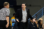 21 March 2015: Ohio State head coach Kevin McGuff (right) talks with referee Mark Zentz  (left). The Ohio State University Buckeyes played the James Madison University Dukes at Carmichael Arena in Chapel Hill, North Carolina in a 2014-15 NCAA Division I Women's Basketball Tournament first round game.