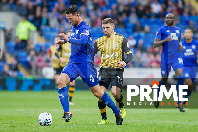 Sean Morrison of Cardiff City beats Gary Hooper of Sheffield Wednesday to the ball during the Sky Bet Championship match between Cardiff City and Sheffield Wednesday at Cardiff City Stadium, Cardiff, Wales on 16 September 2017. Photo by Mark  Hawkins / PRiME Media Images.