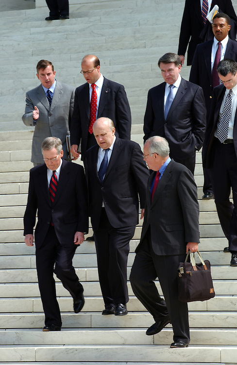 Senator Mitch McConnell, R-KY and his legal team, Ken Star and Floyd Abrams make their way to a press conference at the U.S. Supreme Court during oral arguments in the McConnell vs. FEC.