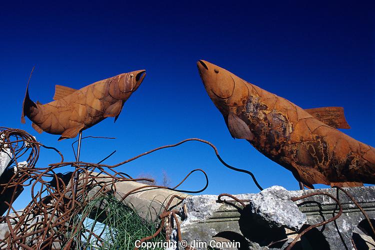 Salmon sculpture along Elliott Bay West Seattle on a sunny blue sky day Seattle Washington State USA