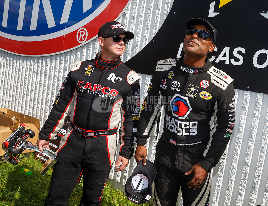 Sep 3, 2016; Clermont, IN, USA; NHRA top fuel driver Steve Torrence (left) and Antron Brown during qualifying for the US Nationals at Lucas Oil Raceway. Mandatory Credit: Mark J. Rebilas-USA TODAY Sports