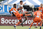 03 July 2012: Carolina's Gale Agbossoumonde (left)defends against Atlanta's Matt Horth (in gray). The Carolina RailHawks defeated the Atlanta Silverbacks 2-1 at WakeMed Soccer Stadium in Cary, NC in a 2012 North American Soccer League (NASL) regular season game.