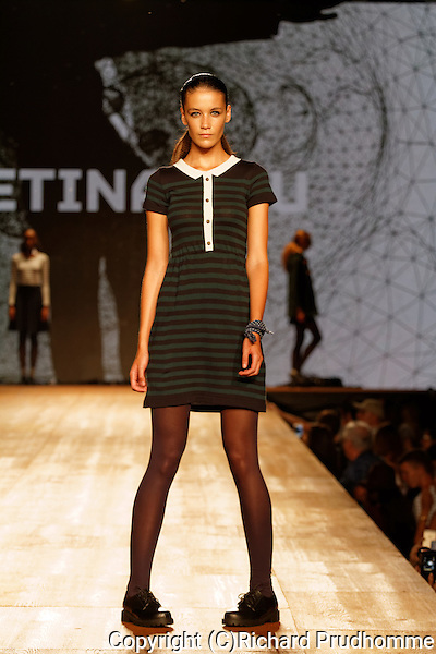 A model poses on the runway at the Betina Lou fashion show held during the Fashion and Design Festival in Montreal