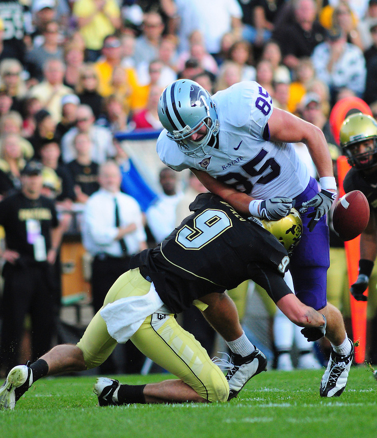 18 October 08: Kansas State tight end Jeron Mastrud (85) is forced to drop a pass as Colorado safety D.J.Dykes (9) tackles him. The Colorado Buffaloes defeated the Kansas State Wildcats 14-13 at Folsom Field in Boulder, Colorado.