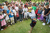 Dance session at a summer festival organised by Walterton and Elgin Community Homes, a resident-controlled housing association in North Paddington, London.
