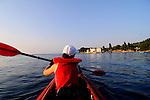Mit dem Kanu auf Erkundungstour der Kueste nahe Glavotok; with the canoe discovering the coast around Glavotok, Kloster Glavotok, Monastery of Glavotok, Krk Island, Dalmatia, Croatia. Insel Krk, Dalmatien, Kroatien. Krk is a Croatian island in the northern Adriatic Sea, located near Rijeka in the Bay of Kvarner and part of the Primorje-Gorski Kotar county. Krk ist mit 405,22 qkm nach Cres die zweitgroesste Insel in der Adria. Sie gehoert zu Kroatien und liegt in der Kvarner-Bucht suedoestlich von Rijeka.