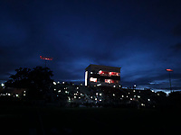 NWA Democrat-Gazette/ANDY SHUPE<br /> The stadium lights go out moments before the start of the Springdale and Alma game Friday, Sept. 7, 2018, at Jarrell Williams Bulldog Stadium in Springdale. Visit nwadg.com/photos to see photographs from the game.