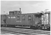 Side-end angle view of long caboose #04343, flying herald, round roof.<br /> D&amp;RGW    Taken by Porter, Jerry F.
