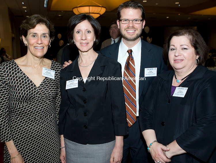 WATERBURY, CT - 16 APRIL 2009 -041609JT19-<br /> From left, Board of Directors chairman Nancy Becker of Torrington Supply Company, Inc. with JoAnn Reynolds-Balanda, Board member Tom Burden of People's United Bank, and Joanne Murgalo during the the United Way of Greater Waterbury's 23rd annual Community Leaders and Awards dinner on Thursday at the Holiday Inn in Waterbury. Award recipients were Paul Tornaquindici of ShopRite Supermarkets with the Community Volunteer of the Year Award, Frederick Luedke with wife Jeanne, president of NEOPERL, Inc. of Waterbury with the Frederic and Lucy Kellogg Award, Jennifer Carbonaro representing Waterbury Companies, Inc. with the Spirit of Excellence Award, and Fernando Ramirez, president of the Waterbury Firefighters Association Local 1339, receiving the Organized Labor/United Way Community Service Award.<br /> Josalee Thrift Republican-American