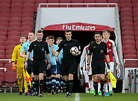Referee Craig Hicks leads the teams onto the pitch<br /> <br /> Photographer Andrew Kearns/CameraSport<br /> <br /> Emirates FA Youth Cup Semi- Final Second Leg - Arsenal U18 v Blackpool U18 - Monday 16th April 2018 - Emirates Stadium - London<br />  <br /> World Copyright &copy; 2018 CameraSport. All rights reserved. 43 Linden Ave. Countesthorpe. Leicester. England. LE8 5PG - Tel: +44 (0) 116 277 4147 - admin@camerasport.com - www.camerasport.com