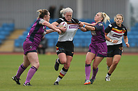Picture by Paul Currie/SWpix.com - 07/10/2017 - Rugby League - Women's Super League Grand Final - Bradford Bulls v Featherstone Rovers - Regional Arena, Manchester, England - Beth Sutcliffe of Bradford Bulls is tackled by Sinead Poach of Featherstone Rovers and Emma Slone