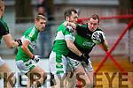 Kevin Breen Legion tackles Ciaran O'Shea Nemo Rangers during the AIB Munster club SFC clash in Pairc Uí Rinn on Sunday