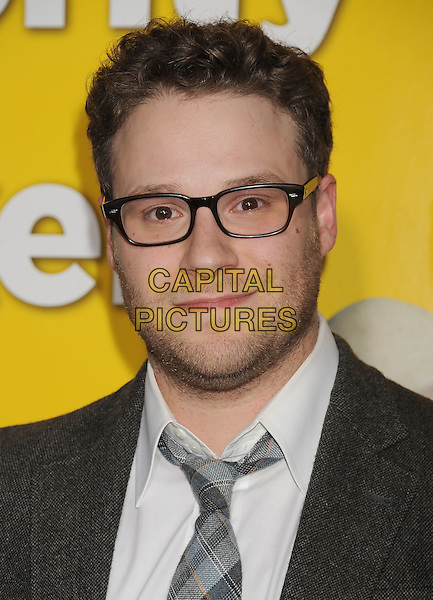 "SETH ROGEN .arriving at the Los Angeles premiere of ""Paul"" at Grauman's Chinese Theatre in Hollywood, California, USA, .March 14th, 2011. .portrait headshot beard facial hair  grey gray tie jacket glasses plaid  white shirt .CAP/ROT/TM.©TM/Roth/Capital Pictures"