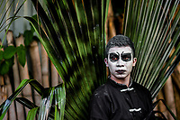 A Salvadoran young man, with white face paint, takes part in the La Calabiuza parade at the Day of the Dead celebration in Tonacatepeque, El Salvador, 1 November 2016. The festival, known as La Calabiuza since the 90s of the last century, joins Salvador's pre-Hispanic heritage and the mythological figures (La Sihuanaba, El Cipitío, La Llorona etc.) collected from the whole Central American region, together with the catholic All Saints Day holiday and its tradition of honoring the dead relatives. Children and youths only, dressed up in scary costumes and carrying painted carts, march from the local cemetery to the downtown plaza where the party culminates with music, dance, drinking and eating pumpkin (Ayote) with honey.