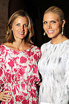 Amanda Brooks and Lindsey Love at a cocktail party at the home of Becca Cason Thrash featuring a trunk show from Christos Garkinos, owner of the L.A. boutique Decadestwo Wednesday April 21,2010.. (Dave Rossman Photo)