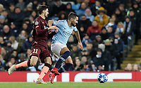Manchester City's Ilkay Gundogan holds off the challenge from  1899 Hoffenheim's Florian Grillitsch<br /> <br /> Photographer Rich Linley/CameraSport<br /> <br /> UEFA Champions League Group F - Manchester City v TSG 1899 Hoffenheim - Wednesday 12th December 2018 - The Etihad - Manchester<br />  <br /> World Copyright © 2018 CameraSport. All rights reserved. 43 Linden Ave. Countesthorpe. Leicester. England. LE8 5PG - Tel: +44 (0) 116 277 4147 - admin@camerasport.com - www.camerasport.com