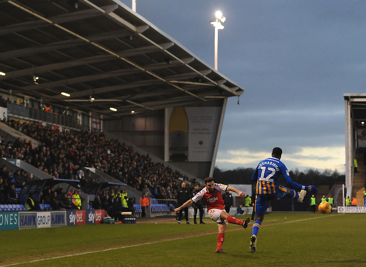 Fleetwood Town's Lewie Coyle crosses despite the attentions of Shrewsbury Town's Fejiri Okenabirhie<br /> <br /> Photographer Kevin Barnes/CameraSport<br /> <br /> The EFL Sky Bet League One - Shrewsbury Town v Fleetwood Town - Tuesday 1st January 2019 - New Meadow - Shrewsbury<br /> <br /> World Copyright © 2019 CameraSport. All rights reserved. 43 Linden Ave. Countesthorpe. Leicester. England. LE8 5PG - Tel: +44 (0) 116 277 4147 - admin@camerasport.com - www.camerasport.com