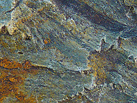 Colorful designs etched in rock.