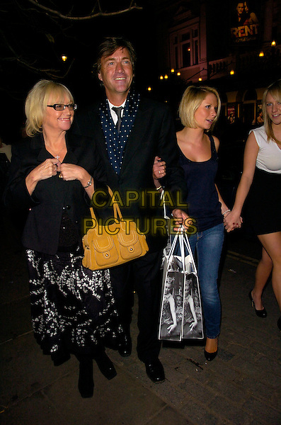 "JUDY FINNIGAN, RICHARD MADELEY, CHLOE MADELEY.The ""Night Of The Snow Queen"" - VIP charity gala afterparty, Bungalow 8 bar & nightclub, St. Martin's Lane, London, England.   .December 12th, 2007.full length jeans denim black white dress leather bag purse skirt top daughter mother father family married husband wife goody bag glasses yellow .CAP/CAN.©Can Nguyen/Capital Pictures"
