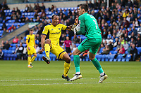 Jonathan Bond of Peterborough United (right) collects the ball ahead of Wes Thomas of Oxford United during the Sky Bet League 1 match between Peterborough and Oxford United at the ABAX Stadium, London Road, Peterborough, England on 30 September 2017. Photo by David Horn.