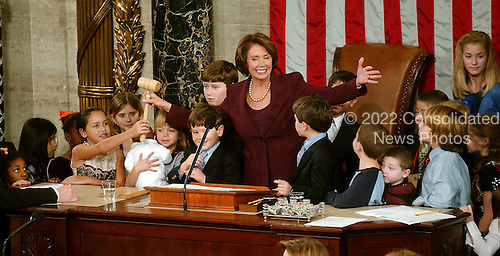 Washington, D.C. - January 4, 2007 --  United States Representative Nancy Pelosi (Democrat of the 8th District of California) welcomes children to the podium to see the gavel after she was sworn-in as the Speaker of the United States House of Representatives in the Capitol in Washington, D.C. on Thursday, January 4, 2007.  Speaker Pelosi is the first woman in U.S. history to serve in that position..Credit: Ron Sachs / CNP
