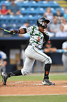 Augusta GreenJackets designated hitter Shawon Dunston (5) swings at a pitch during a game against the Asheville Tourists at McCormick Field on July 16, 2017 in Asheville, North Carolina. The Tourists defeated the GreenJackets 12-3. (Tony Farlow/Four Seam Images)