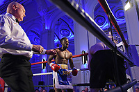 Gelassius Taaru (C) defeats Neil Rawlinson during a Boxing Show at The Devere Grand Connaught Rooms on 9th May 2019