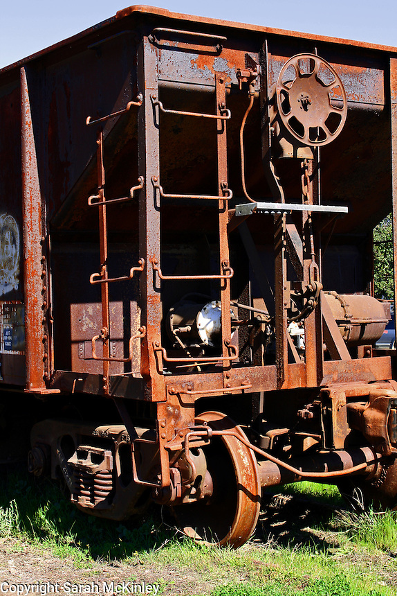 A rusty, abandoned train car on Railroad Avenue in Willits in Mendocino County in Northern California.