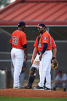 GCL Astros pitching coach Hector Mercado (63) talks with pitcher Diogenes Almengo (53) and catcher Jake Bowey (21) during a game against the GCL Braves on July 23, 2015 at the Osceola County Stadium Complex in Kissimmee, Florida.  GCL Braves defeated GCL Astros 4-2.  (Mike Janes/Four Seam Images)