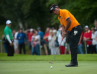 23.05.2015. Wentworth, England. BMW PGA Golf Championship. Round 3.  Thongchai Jaidee [THA]  putts on the 4th green during the third round of the 2015 BMW PGA Championship from The West Course Wentworth Golf Club