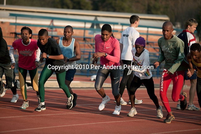 PRETORIA, SOUTH AFRICA - AUGUST 10: Caster Semenya (c), age 19, runs during a training session at the High Performance Center at the university of Pretoria on August 10, 2010 in Pretoria, South Africa. Caster Semenya won the 800 meters world championship gold medal in Berlin in 2009 was recently cleared to run after her career was held back due to gender testing. She grew up in a rural village in Limpopo, northern South Africa, and she started running only a few years ago, and quickly appeared from nowhere to the world stage. After being banned for almost a year she was cleared by the IAAF and cleared to compete in July 2010. (Photo by Per-Anders Pettersson/Getty Images)