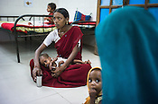 Malnourished children with their mothers are seen at the Nutrition Rehabilitation Centre (NRC) in Burhanpur district of Madhya Pradesh, India. Photo: Sanjit Das/Panos for ACF
