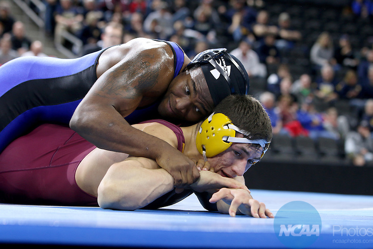 12 MARCH 2016:  Romero Cotton from Neb.-Kearney controls Joe Gomez from Northern St. in their 197 pound weight class at the 2016 NCAA Men's Division II Wrestling Championship at the Denny Sanford Premier Center in Sioux Falls, S.D. Photo by Dave Eggen/NCAA Photos