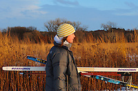 Nelle Rutecki takes out her cross country skis for the first time on Saturday, where she joins several dozen others on the extensive trails in the Arboretum