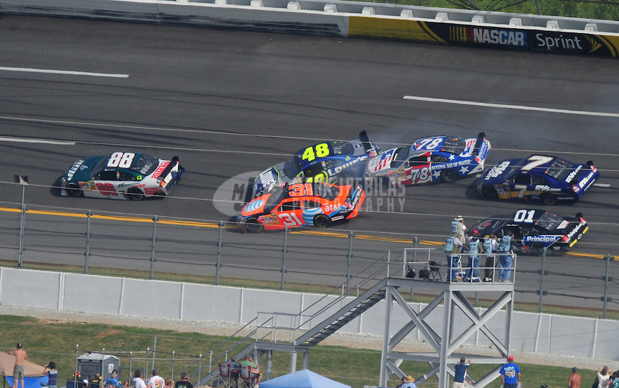 Apr 27, 2008; Talladega, AL, USA; NASCAR Sprint Cup Series driver Dale Earnhardt Jr (88) leads the crashing cars of Jimmie Johnson (48) Jeff Burton (31) and Joe Nemechek (78) during the Aarons 499 at Talladega Superspeedway. Mandatory Credit: Mark J. Rebilas-