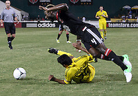 WASHINGTON, DC - AUGUST 4, 2012:  Brandon McDonald (4) of DC United leaps over Jairo Arrieta (25) of the Columbus Crew during an MLS match at RFK Stadium in Washington DC on August 4. United won 1-0.
