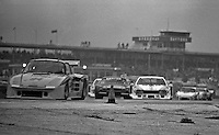 The #94 Whittington Brothers Porsche of Don, Bill, and Dale Whittington  line of cars races through the infield during 24 Hours of Daytona, Daytona International Speedway, February 1, 1981.  (Photo by Brian Cleary/www.bcpix.com)