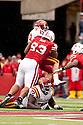 24 October 2009: Nebraska defensive tackle Ndamukong Suh tackling Iowa State wide receiver Josh Lenz at Memorial Stadium, Lincoln, Nebraska. Iowa State defeats Nebraska 9 to 7.