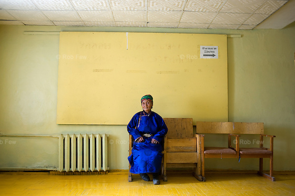 Healthcare provision is also strained. Here, a traditional herder waits in the sparse lobby of an urban clinic.<br />