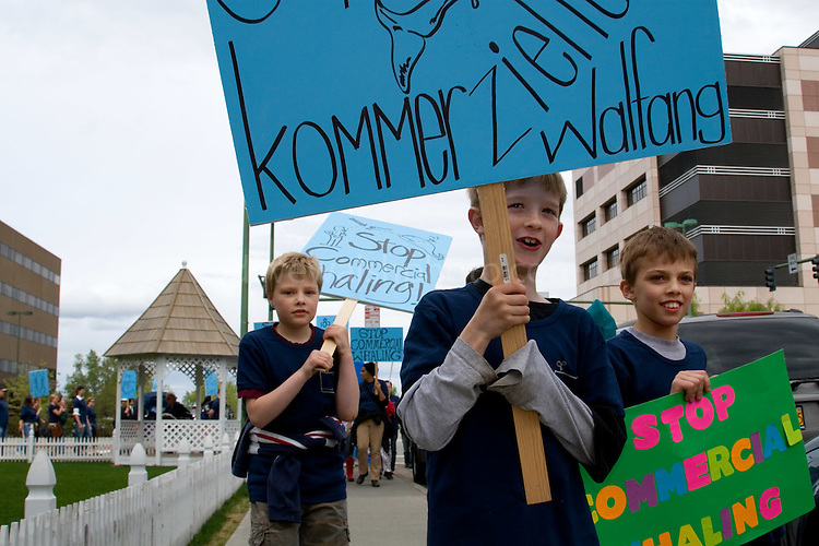 Hundreds of Greenpeace supporters parade through Anchorage, Alaska - venue for the annual International Whaling Commission meeting - as part of a global day of activities with thousands of people across twenty countries and more than fifty cities - to send a message to delegates at the Commission. .Hundreds of thousands of whales die every year because of human impacts such as pollution, ships strikes, climate change and being caught in nets, yet the Commission will focus discussion on where, when and how to hunt them. .copyright: Walsh/Greenpeace