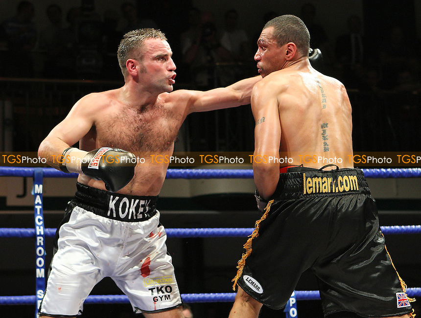Semi-Final: Tony Oakey (Portsmouth, white shorts) defeats Courtney Fry (Wood Green, black shorts) - Prizefighter 'The Light Heavyweights' boxing tournament at York Hall, Bethnal Green, promoted by Matchroom Sports / Barry Hearn - 21/02/09 - MANDATORY CREDIT: Gavin Ellis/TGSPHOTO - Self billing applies where appropriate - 0845 094 6026 - contact@tgsphoto.co.uk - NO UNPAID USE.