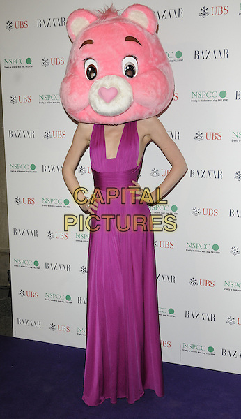 MARGO STILLEY.The Surrealist Ball in aid of NSPCC at The Banqueting House, London, England..March 17th, 2011.full length pink fuschia maxi dress sleeveless hands on hips head mask care bear funny.CAP/CAN.©Can Nguyen/Capital Pictures.